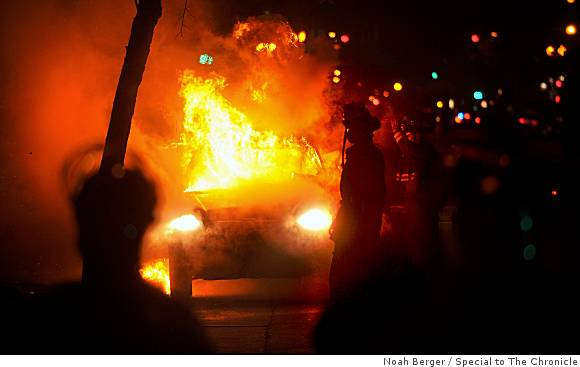 car-burns-at-oakland-riot
